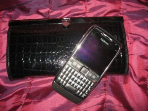 Lovely purse/wallet that resembles a clutch bag and my Nokia E71.